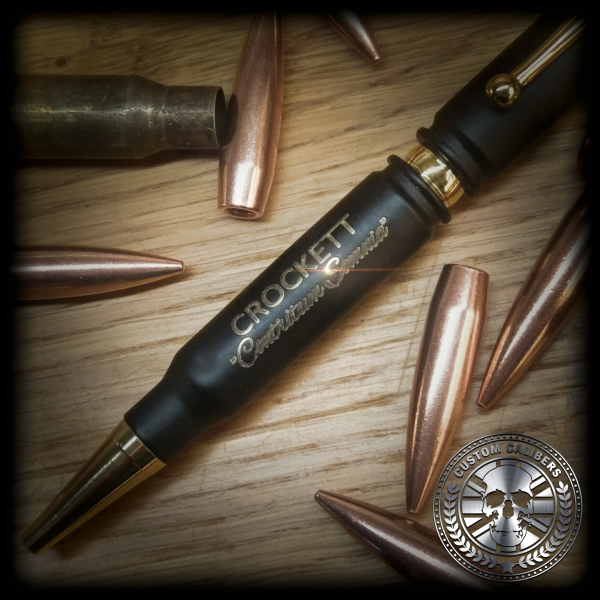 An image of a crockett pen with bullets surrounding it