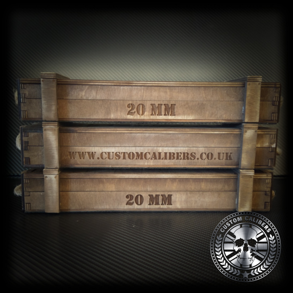 An image of three wooden cases all engraved and the custom calibers logo at the bottom right