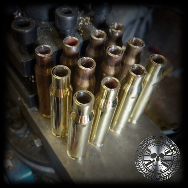 A professional image of several golden bullet bottle openers being made