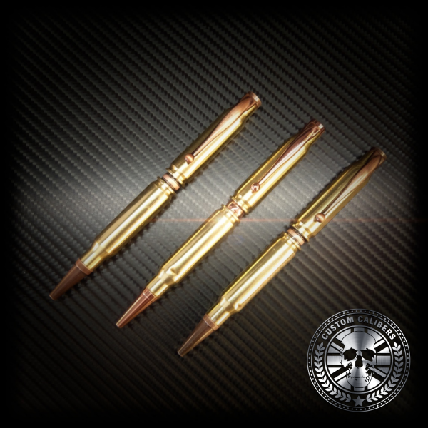 An image of three shining golden pens and custom calibers logo at the bottom right