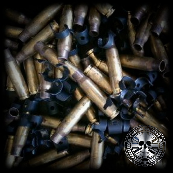 A picture of a bunch of bullets with the custom calibers logo at the bottom right