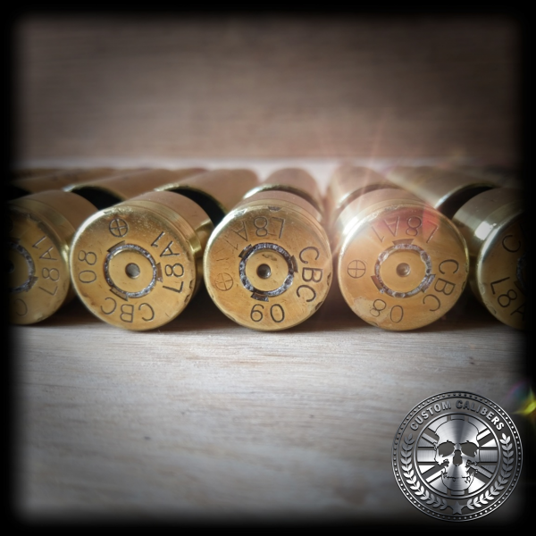 A picture of five bullet ends with the custom calibers logo on the bottom right