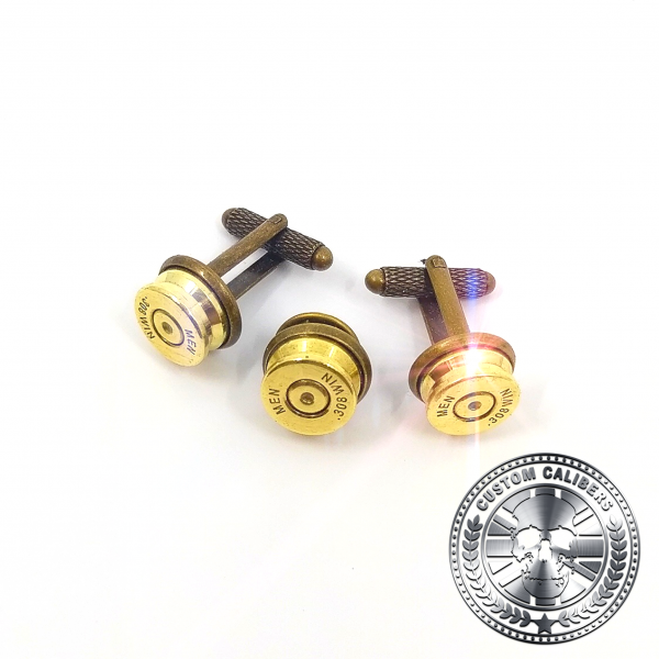A picture of three golden cuff links for men which have the custom calibers logo at the bottom right