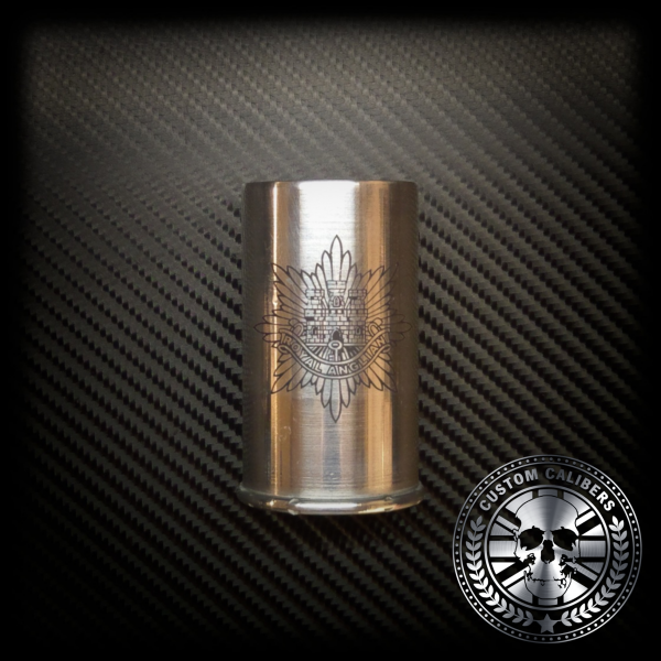A picture of a cut out bullet mug with custom calibers logo at the bottom right