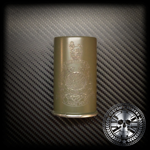 A golden cup flask with engraving and custom calibers logo at the bottom right