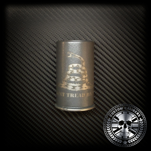 A wondrous image of a grey tinted flask with engraving and the custom calibers logo at the bottom right