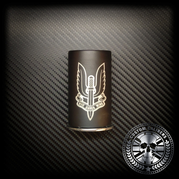 A truly incredible picture of a brown engraved canister flask with custom calibers logo at the bottom right