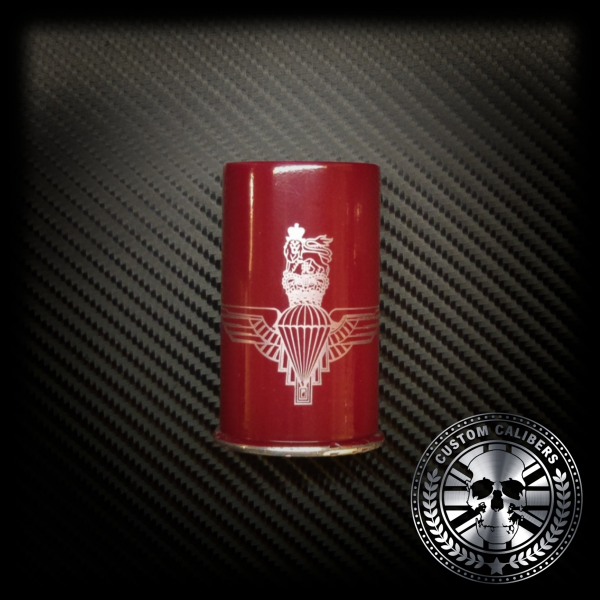 A professional image of a red cup with engraving and the custom calibers logo at the bottom right