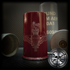 A picture of a red bullet mug with the custom calibers logo at the bottom right