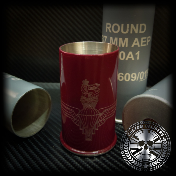 A wondrous image of a red canister with three other grey canisters