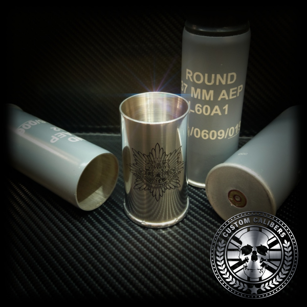 A picture of four bottle canisters with custom calibers logo at the bottom right