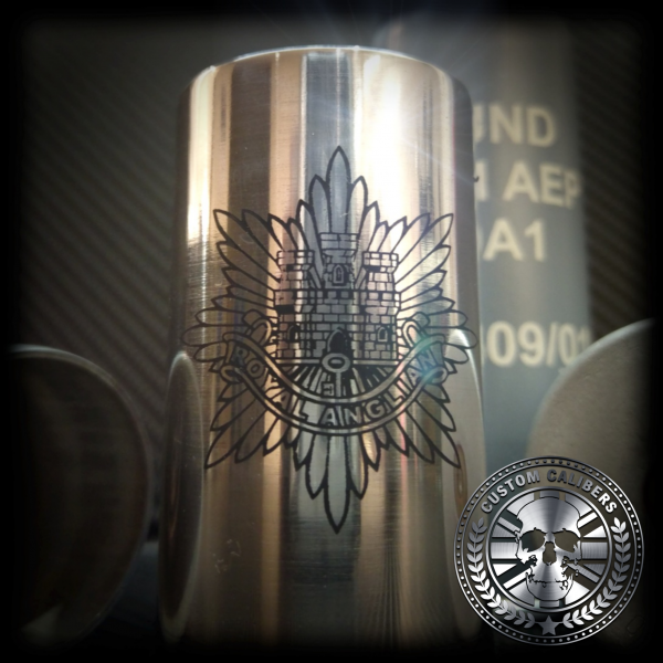 A wondrous image of a silver flask with engraving and custom calibers logo at the bottom right