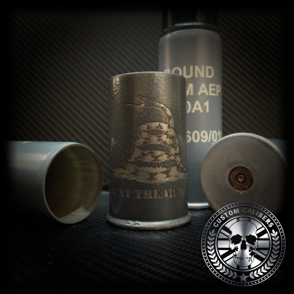 Another image of four canisters used as flasks the front one being engraved