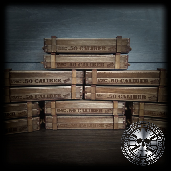 A picture of twelve wooden cases with engravings of the custom caliber logo at the bottom right