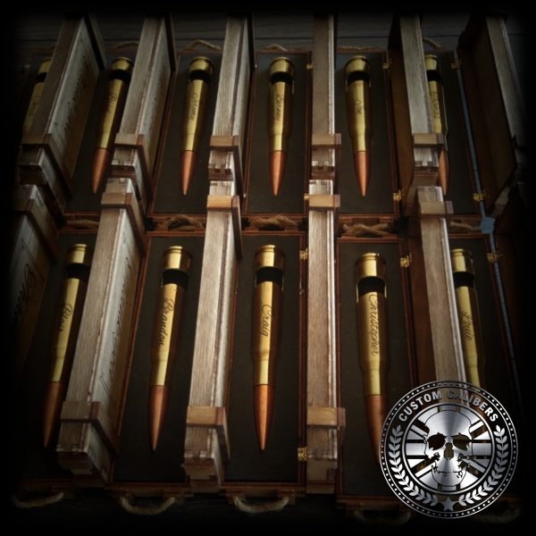 Another image of twelve wooden cases open with bullet bottle openers within them