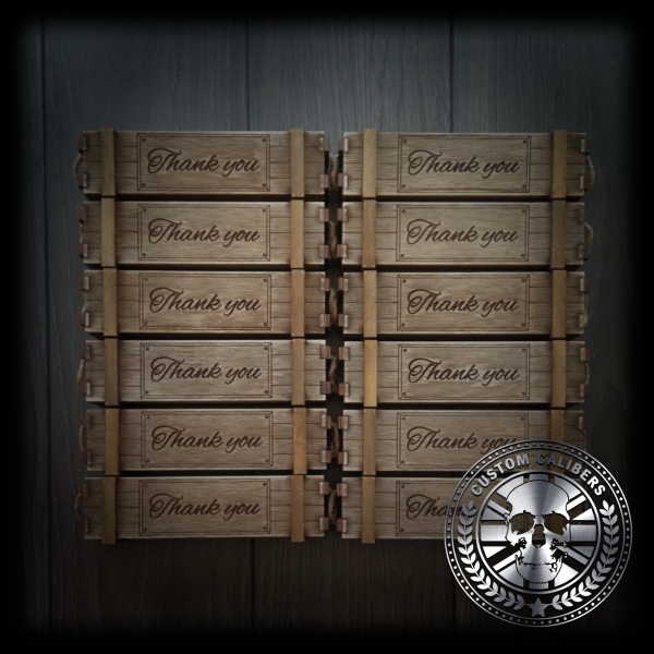 A truly incredible image of twelve engraved wooden cases with the custom calibers watermark at the bottom right