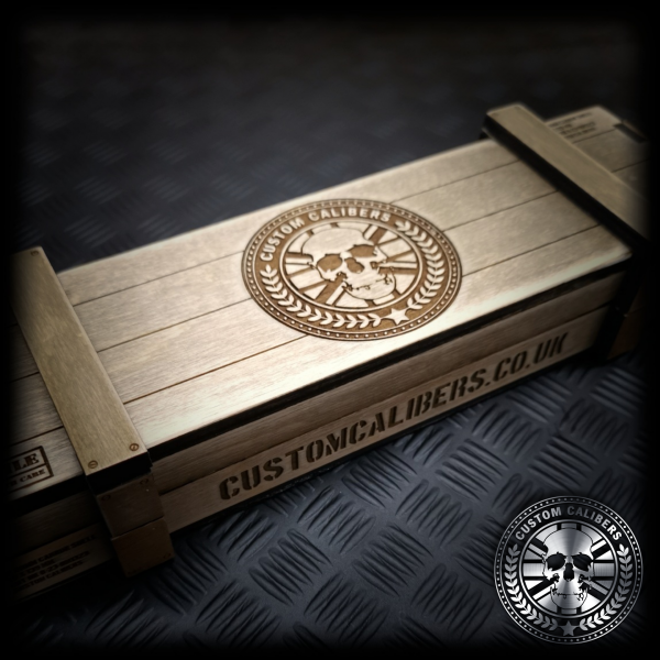 Close up of the gift crate the 20mm Cannon Shell Bottle Opener comes in with the Custom Calibers logo engraved on top and the company website 'customercalibers.co.uk' engraved on the side
