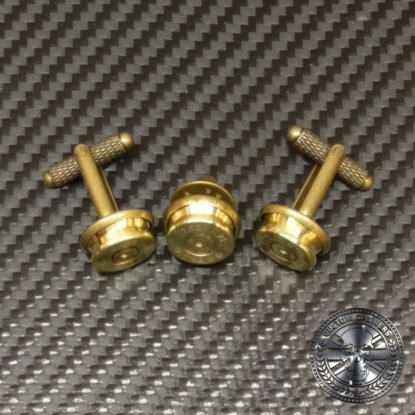 Another close up image of three golden cuff links with the custom calibers logo at the bottom right