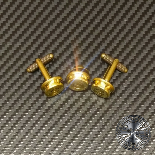 A picture of three golden bullet cuff links with the custom calibers logo at the bottom right