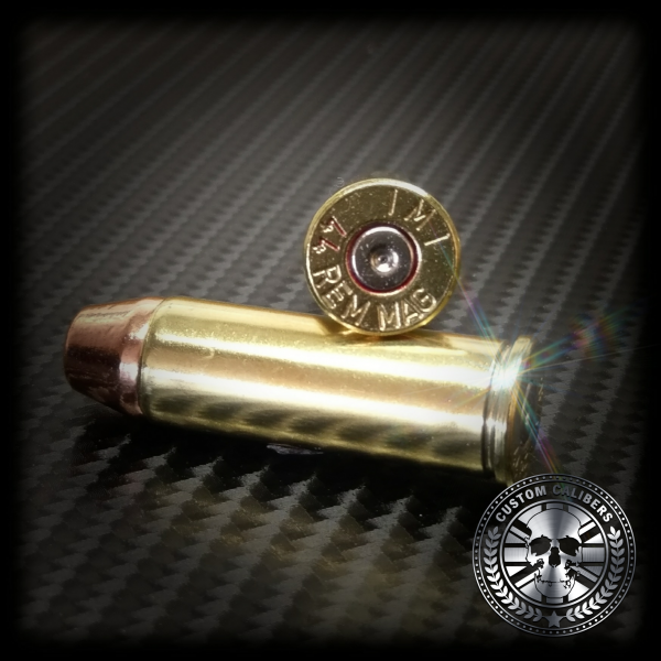 An image of two 9mm bullets one on top of the other with the custom calibers logo in the bottom right