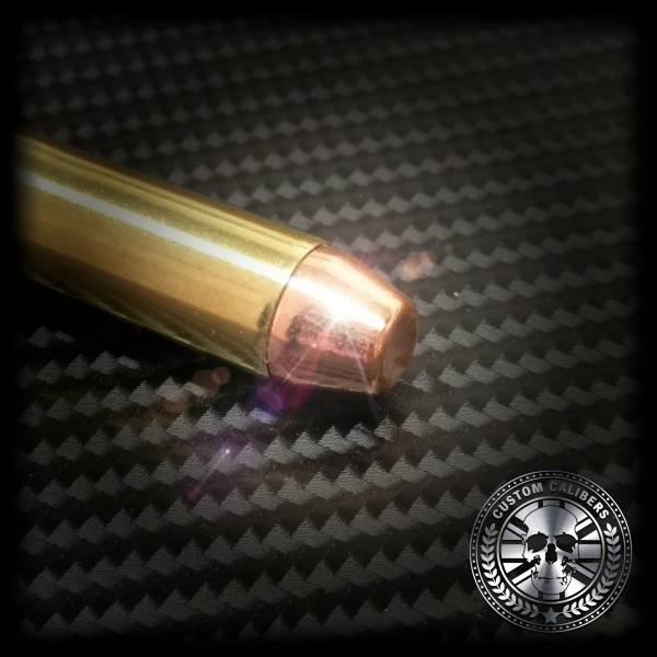 Another shining picture of a 9mm bullet key ring with emphasis on the snub with custom calibers logo at the bottom right