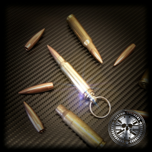 Another one of a kind image with eight 9mm bullets with the centre piece being a 9mm bullet key ring with the custom calibers logo at the bottom right