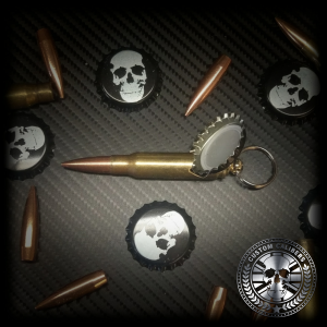 A picture of various 9mm bullets with a 9mm bullet keyring being the centre piece with various skull bottle caps around it