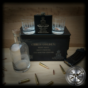 A second of our two glasses, bottle, hip flask, case, bullet magazine, bullets on a wooden surface