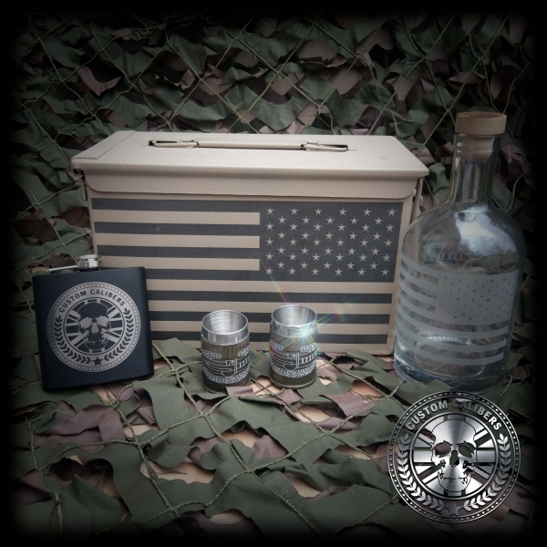 Another image of a case with american flag as well as two steel mugs a custom calibers hip flask and bottle with american flag