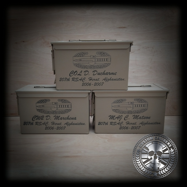 A picture of three boxes with engravings on them and the custom calibers logo at the bottom right