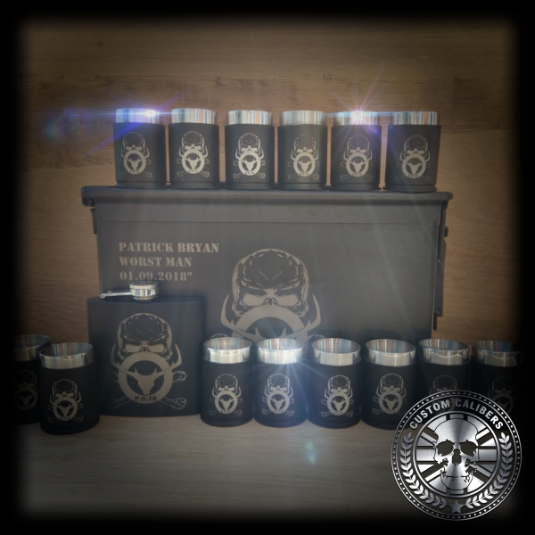 Another image of a custom made case with custom made mugs and hip flask by custom calibers with logo at the bottom right