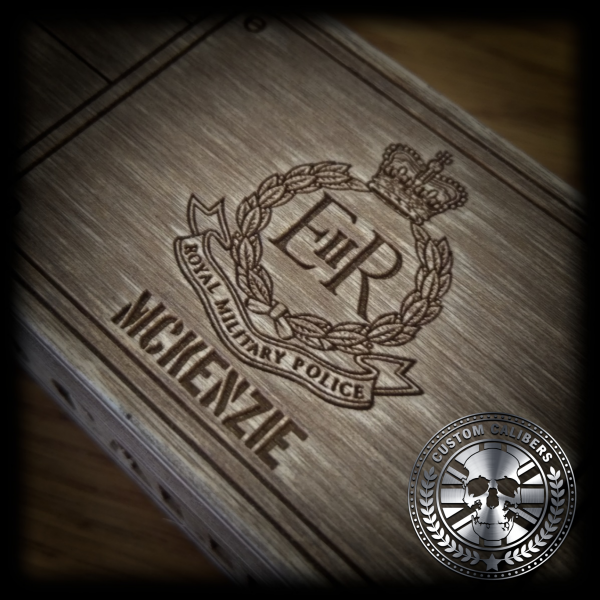 A professional picture of an engraved case with custom calibers logo at the bottom right