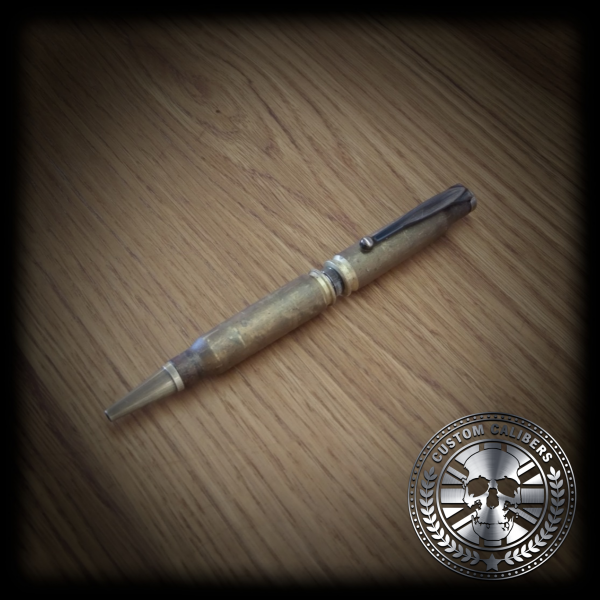 A picture of a pen on wooden table