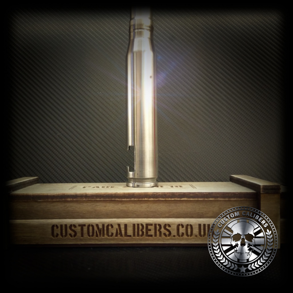A professional image of a a silver artillery shell bottle opener on top of a case