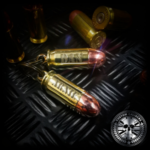 a professional photo of two of our .45 ACP bullet keyrings engraved with individual names
