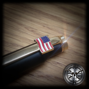 A side image of a 308 bullet with with american flag on wooden surface with custom calibers on the bottom right