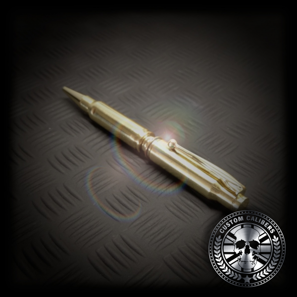 Another incredible photograph of a golden pen with black metal background