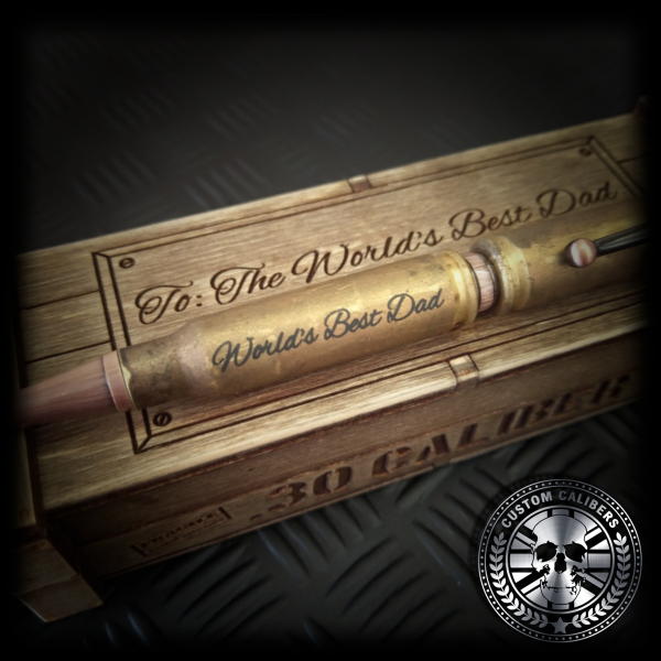 "A custom made bullet with ""worlds best dad"" engraved on a wooden box"
