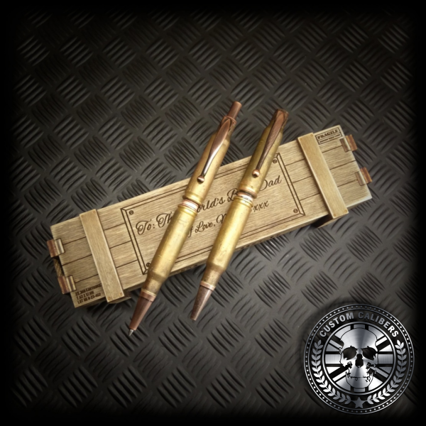 a matching set of bullet pen and bullet pencil sitting on top of a handmade wooden ammo crate gift box