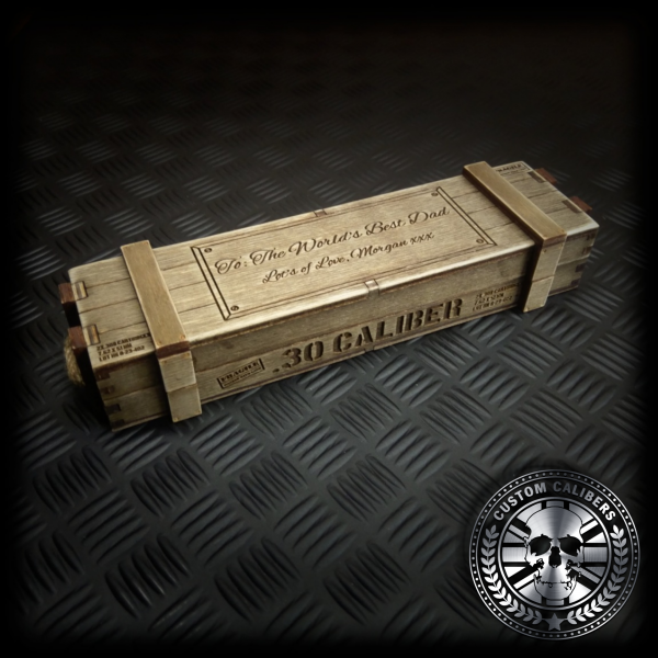 """A handmade ammo crate style gift box made for the custom calibers bullet pens engraved witha custom messge and """".30 caliber"""" along the front of the gift box"""