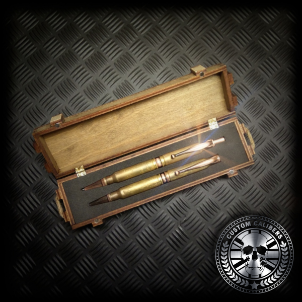 A matching bullet pen and bullet pencil made from real bullets displayed in a handmade wooden presentation ammo crate gift box