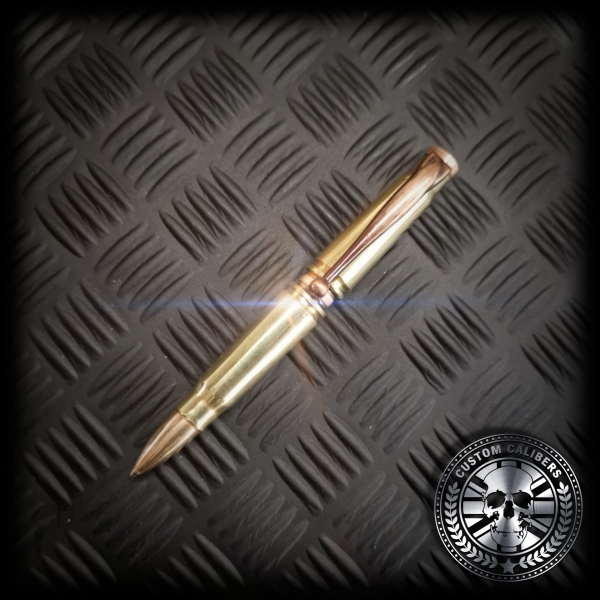A full shot of the polished brass AK-47 Bullet pen with copper pen accents and a real FMJ copper bullet head