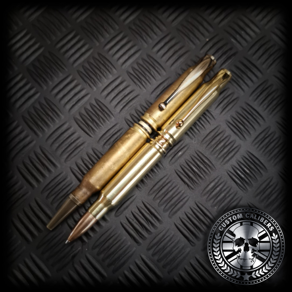 A comparison of the old 308 bullet pen and the new FMJ bullet head bullet pen placed side by side