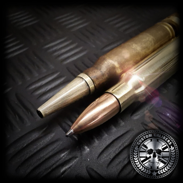 A comparison of the old 308 bullet pen tip and the new FMJ copper bullet head bullet pens