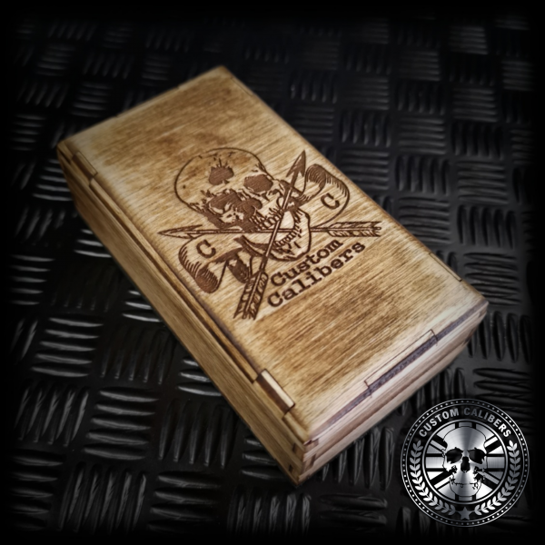 the purpose built wooden gift box made for a side shot of the 50 caliber bullet lighter