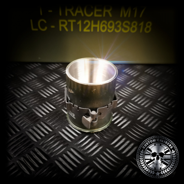 A close up view of a grenade shot glass showing the link and the inside of the shot glass and