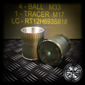 A side view looking at the bottom of the grenade casing showing the primer of the upcycled 40mm grenade shot glass