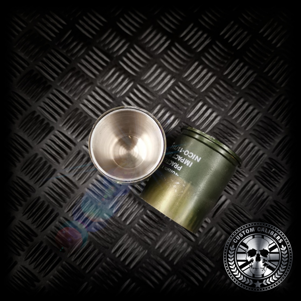 A birds eye view looking into a grenade shot glass showing the stainless steel inners of the upcycled drinking shot glass