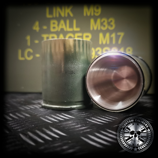 A close up macro shot looking into a grenade shot glass showing the stainless steel inners of the handmade shot glass