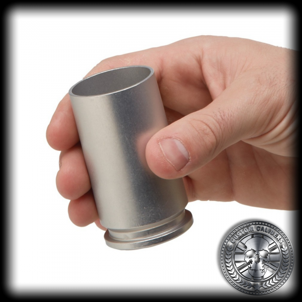 a matt silver 30mm A10 Warthog casing cut and turned into an awesome shot glass